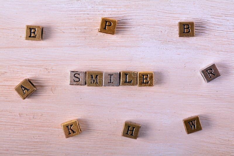 Uśmiechu słowa metalu blok zdjęcia royalty free