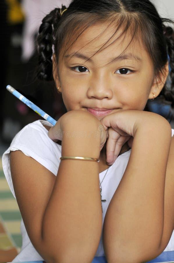 uśmiechu ucznia potomstwa fotografia stock