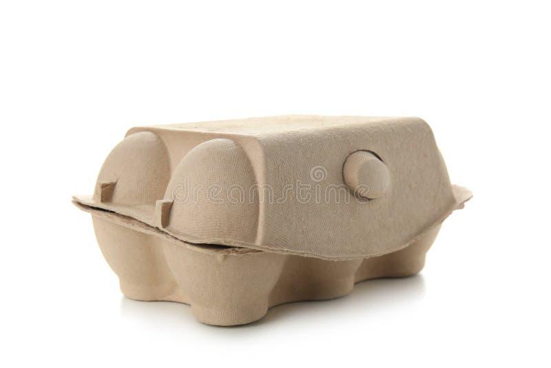 Używać jajeczny pakunek na białym tle Przetwarza? poj?cie zdjęcie royalty free