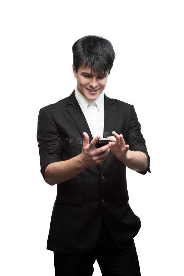 Używać telefon komórkowy szczęśliwy uśmiechnięty biznesmen fotografia stock