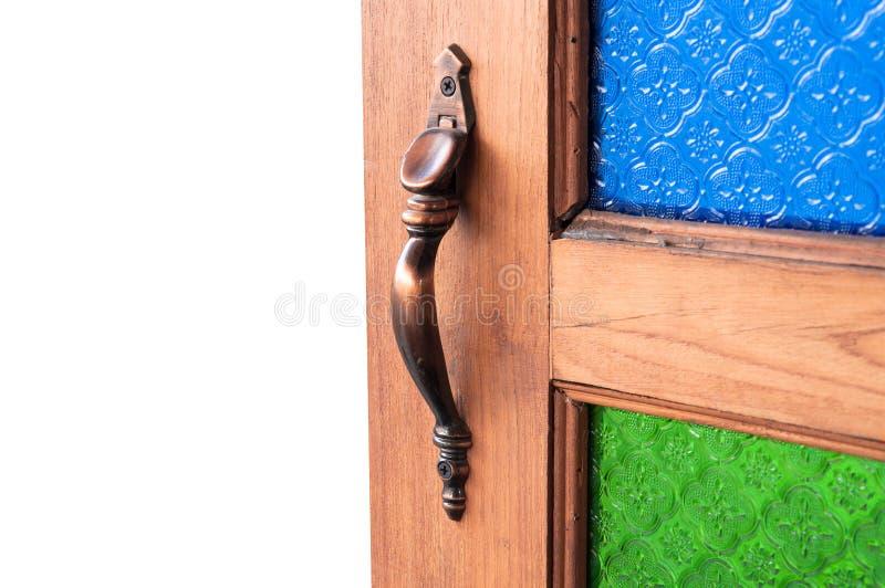 Używają otwierać drzwiowego chwyta, drzwiowe rękojeści barwią rocznika szkło, część drewniany drzwi zdjęcia stock