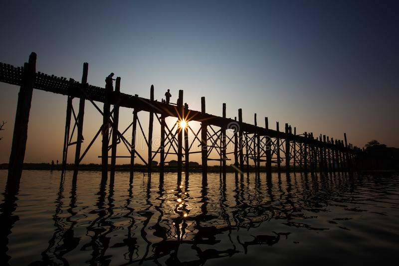 U bein bridge - famous and longest teak wood bridge over Taungthaman Lake, Myanmar royalty free stock photography