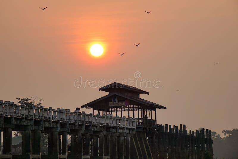 U Bein Bridge in Mandalay, Myanmar. U Bein Bridge at sunrise in Mandalay, Myanmar. U Bein Bridge is the longest teakwood footbridge in the world, spanning 1.2km royalty free stock image