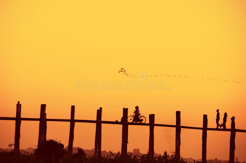 U Bein bridge and people at sunset. Famous U Bein bridge and people at sunset, Myanmar royalty free stock photography