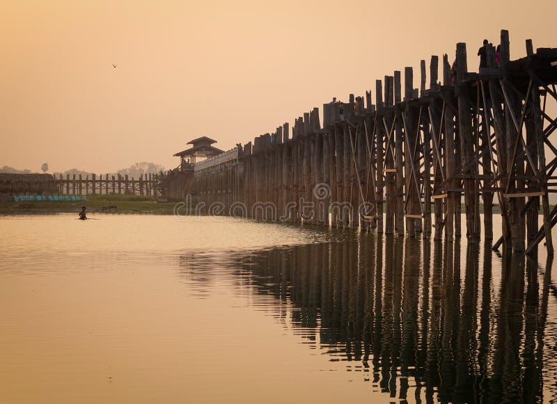 U Bein Bridge in Mandalay, Myanmar. U Bein Bridge at sunrise in Mandalay, Myanmar. U Bein Bridge has become one of Myanmar iconic landmarks stock image