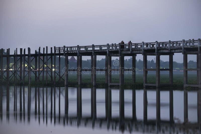 U-Bein Bridge at Taung Tha Man Lake, Mandalay, Myanmar. At sunset stock image
