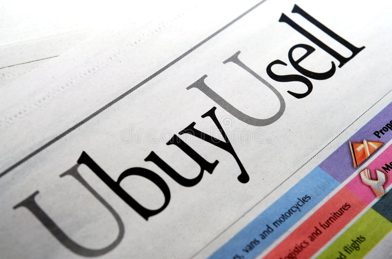 U buy u sell wording. At the news paper royalty free stock photography