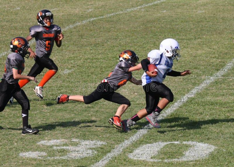 11u młodości futbolowy biegacz na 30 bocznej linii boiska zdjęcia stock