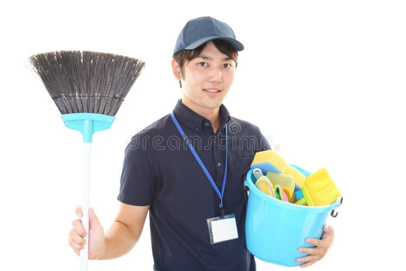 U?miechni?ty Azjatycki janitor fotografia royalty free