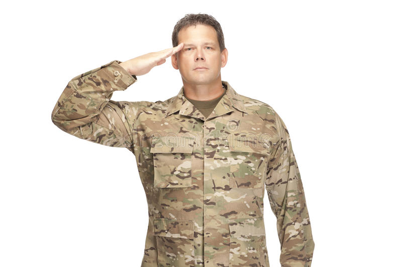 U.S. Army Soldier, Sergeant. Isolated and saluting. U.S. Army Soldier, Sergeant. Isolated and saluting with a serious look stock images