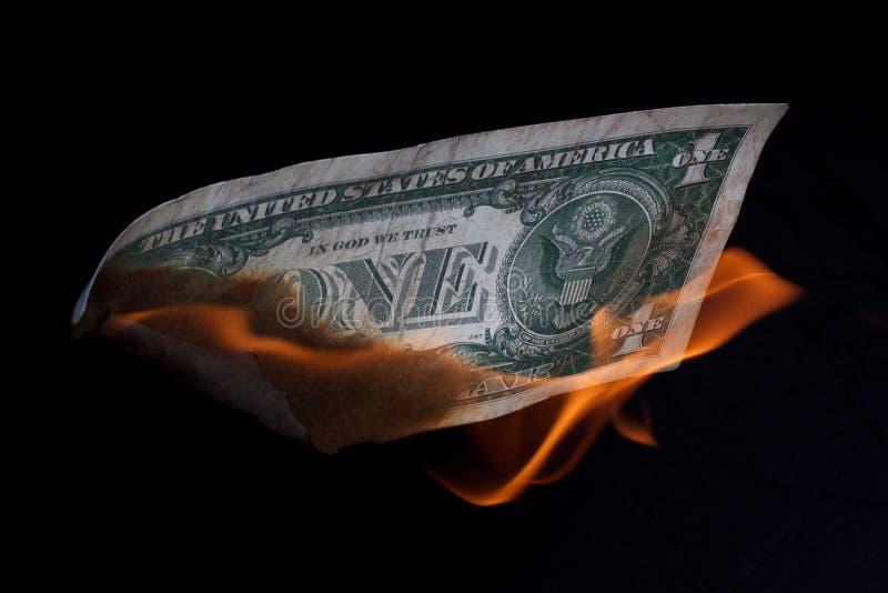 U.S. burning del dólar imagen de archivo