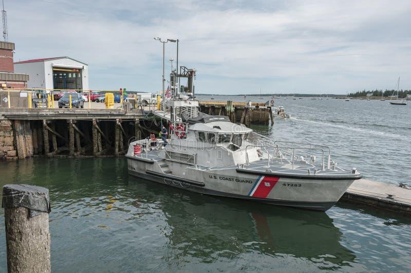 U. S. Coast Guard Motor Life Boat alongside dock stock photo