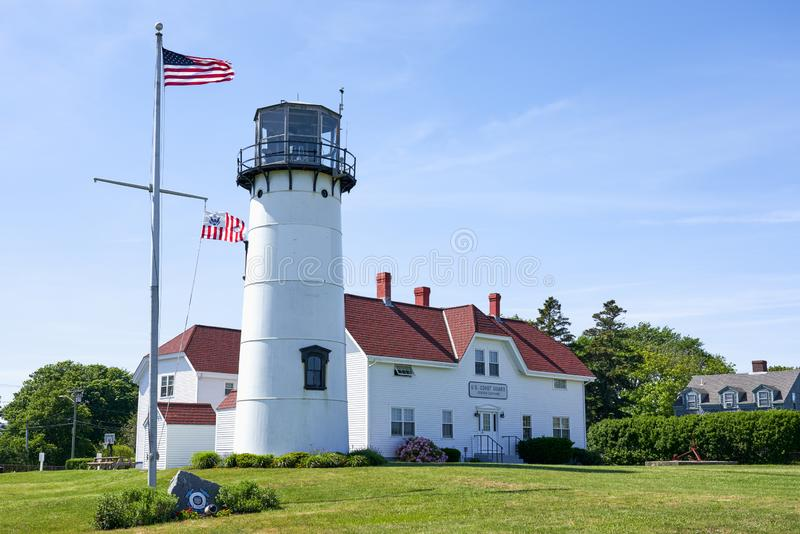 U.S. Coast Guard Station and lighthouse in Chatham, MA. Chatham, MA - June 15, 2019: U.S. Coast Guard Station and lighthouse with United States and Coast Guard stock images