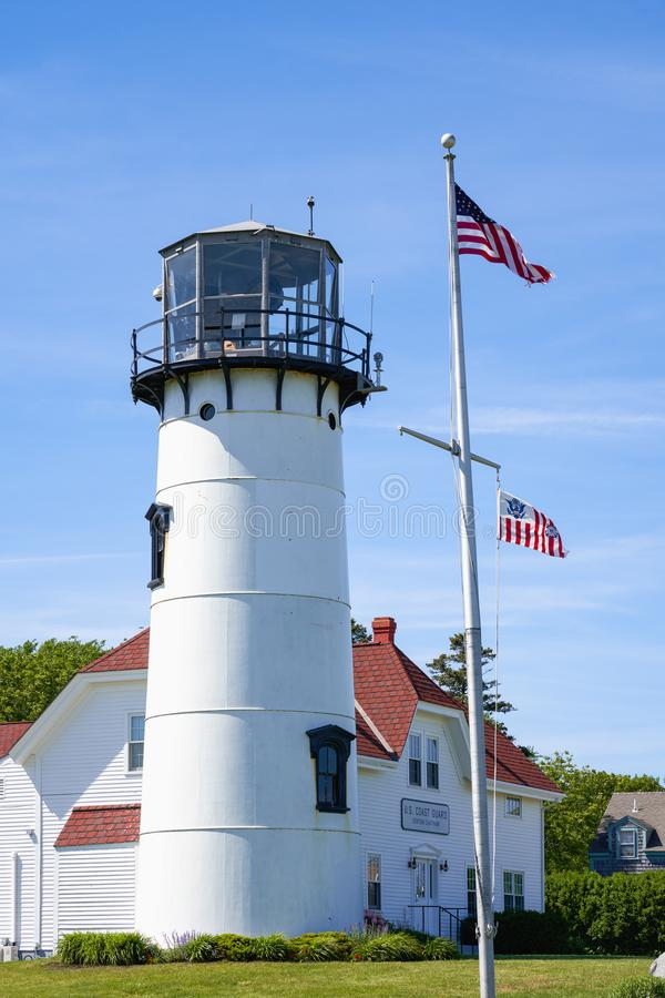 U.S. Coast Guard Station and lighthouse in Chatham, MA. Chatham, MA - June 15, 2019: U.S. Coast Guard Station and lighthouse with United States and Coast Guard stock photos