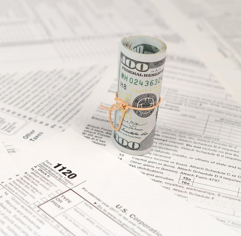 1120 Tax Form Lies Near Hundred Dollar Bills And Blue Pen