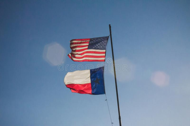 U S en Texas State Flags stock afbeeldingen