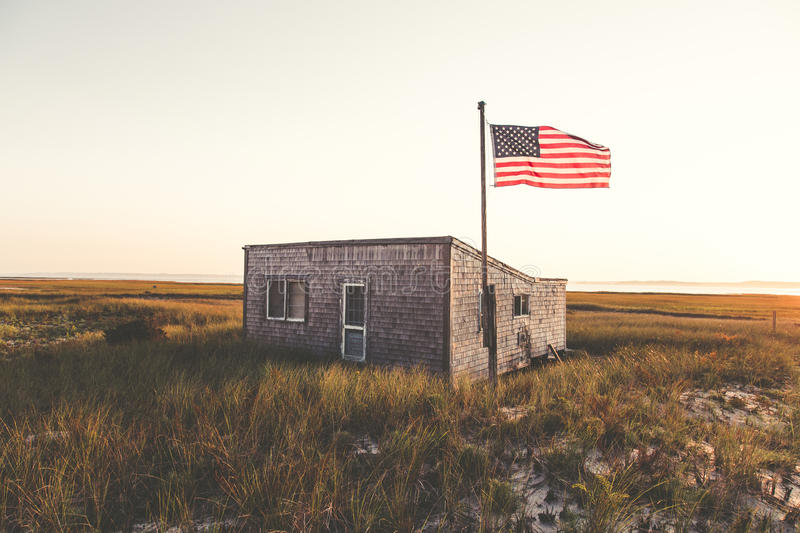 U.s Flag On Green Grassland In Front Of Gray Concrete House Free Public Domain Cc0 Image