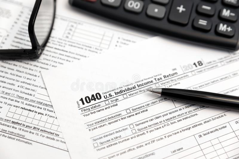 U.S. Individual income tax return. Tax form 1040 with eyeglasses and pen stock photo