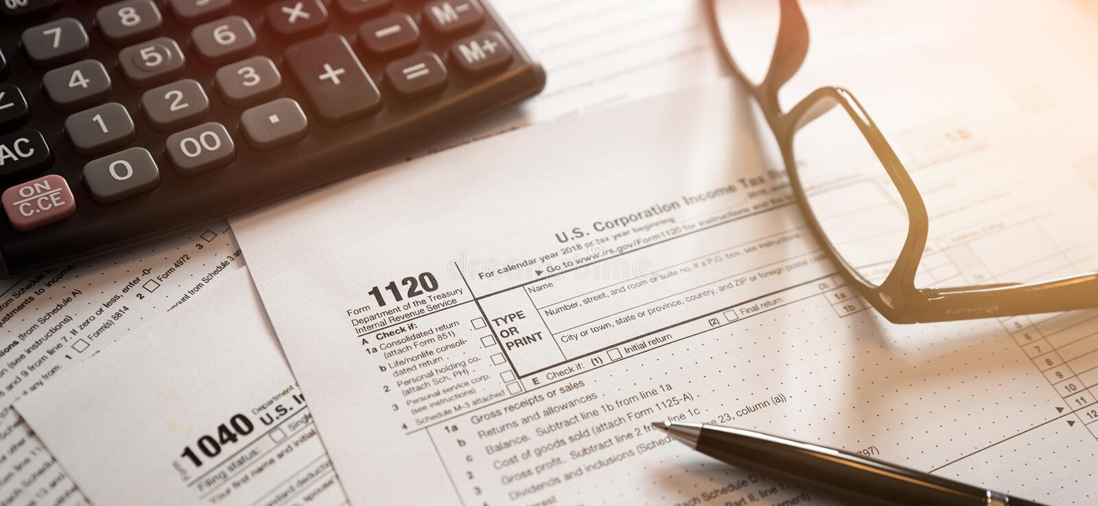 U.S. Individual income tax return. Tax form 1040 with eyeglasses and pen royalty free stock photos