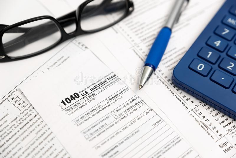 U.S. Individual income tax return. Tax form 1040 with eyeglasses and pen stock image