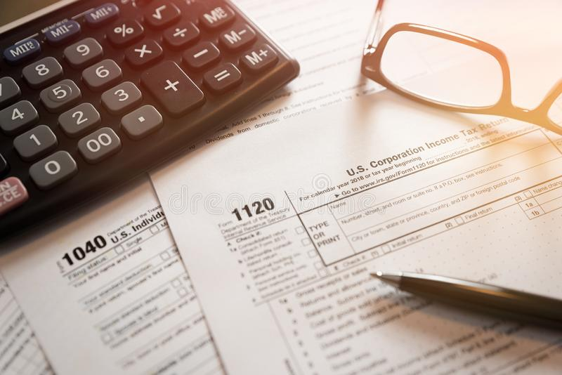 U.S. Individual income tax return. Tax form 1040 with eyeglasses and pen royalty free stock images