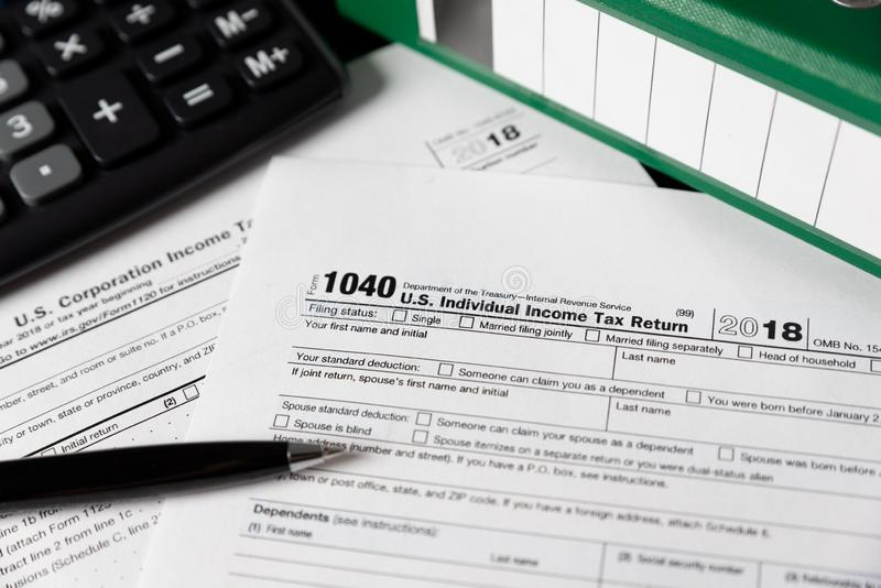 U.S. Individual income tax return. USA tax forms on desk stock images