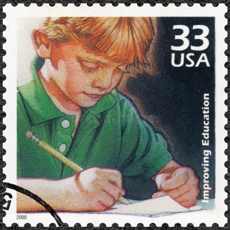 U.S.A. - 2000: la scrittura del bambino di manifestazioni, miglioramento nella qualità di istruzione, serie celebra il secolo, gl fotografie stock
