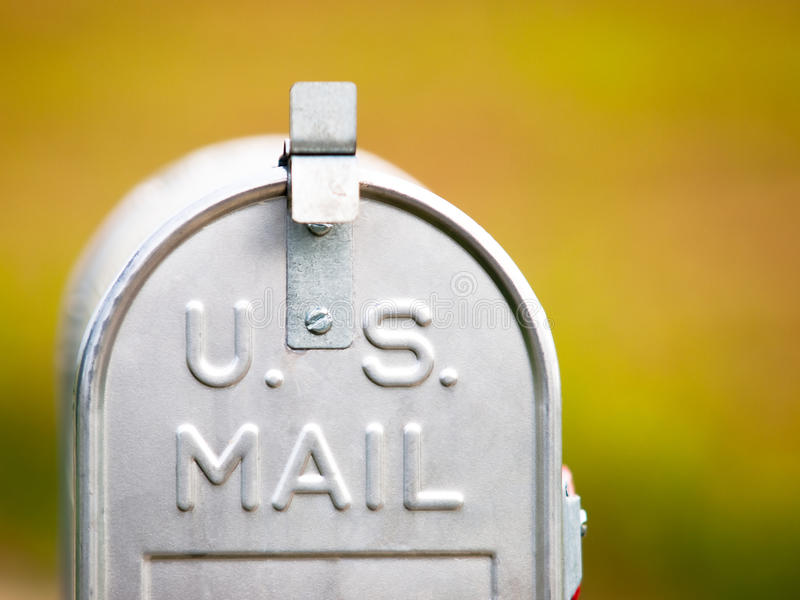U.S. mailbox. Metallic U.S. mailbox with a nice blurred background and limited depth of field