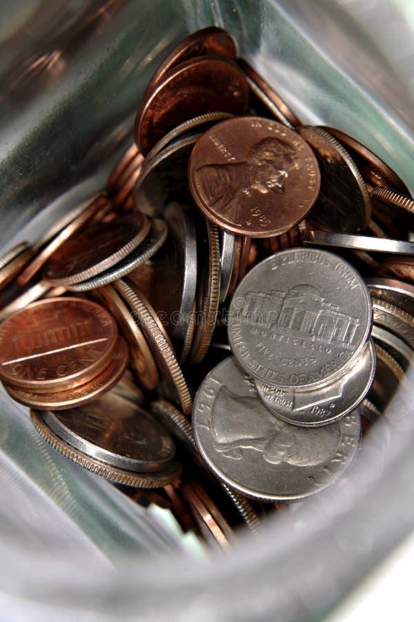 U.S. monete in un vaso fotografia stock libera da diritti