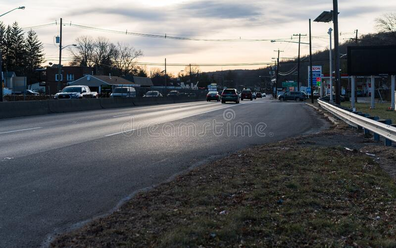 U.S. Route 22 US 22, William Penn Highway close to the intersection with Glenside Ave in Scotch Plains, New Jersey. No traffic. Taken at dusk, sunset, while stock image