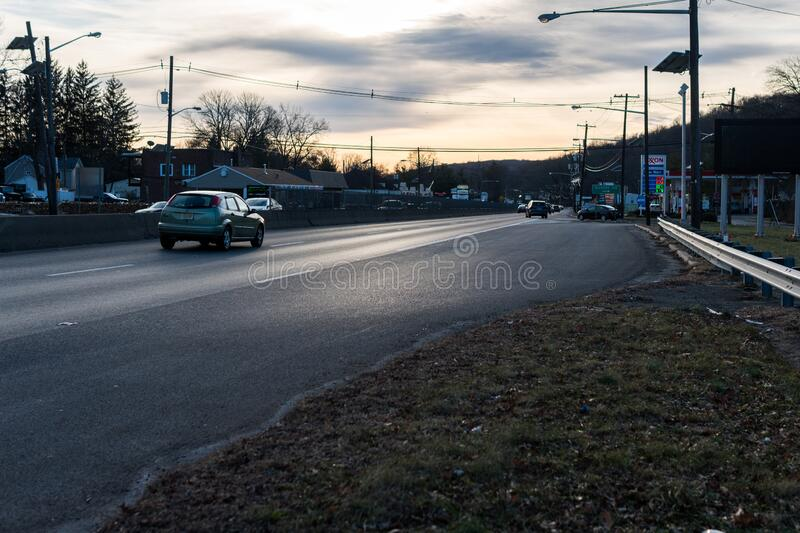 U.S. Route 22 US 22, William Penn Highway close to the intersection with Glenside Ave in Scotch Plains, New Jersey. No traffic, just a car. Taken at dusk stock photo