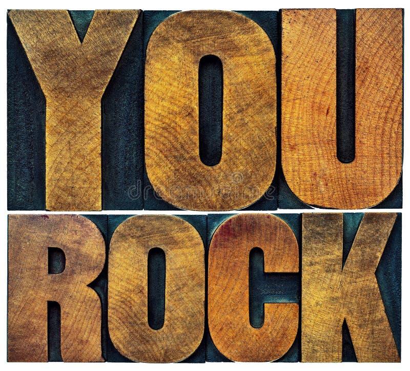 U schommelt in letterzetsel houten type stock foto's
