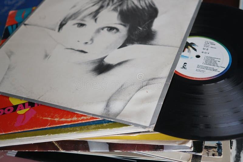 U2 vinyl lp. Rome, Italy - August 8, 2018: Vintage vinyl record Boy, debut studio album by Irish rock band U2 royalty free stock photos