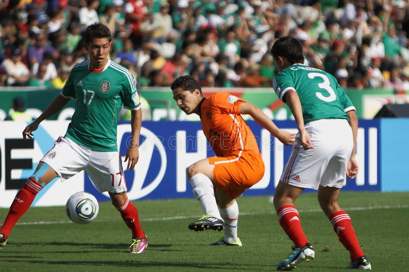 U17 MEX-NED. MONTERREY, MEXICO - JUNE 24: Giovani Casillas (MEX) fights for ball with Anass Achahbar (NED royalty free stock image