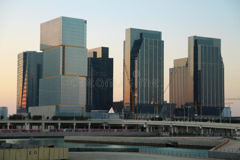 Skyscrapers on Al reem island in Abu Dhabi, United Arab Emirates. UAE, ABU DHABI, FEBRUARY 4, 2016: Skyscrapers on Al reem island in Abu Dhabi - capital and stock photo
