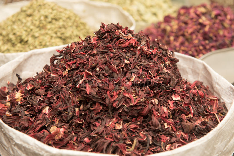 UAE, Dubai, Dry red hibiscus tea leaves and other spices for sale in the spice souq in Deira. royalty free stock photos