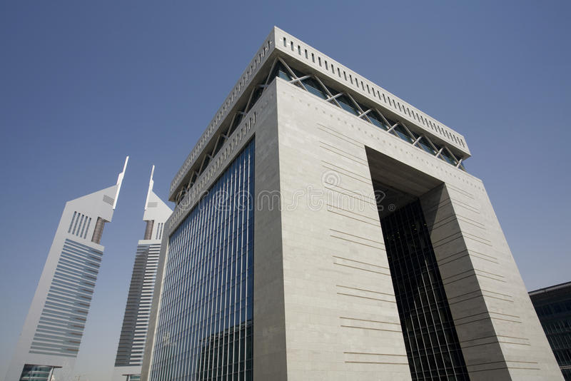 UAE Dubai The Gate building of the Dubai International Financial Centre and the Emirates Towers stock image