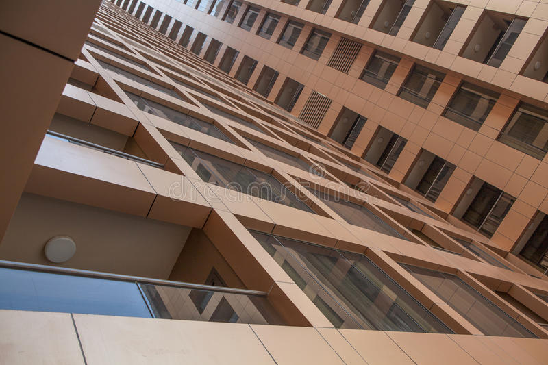 UAE / DUBAI - 9/12/2012 - Modern building seen from below.  royalty free stock images