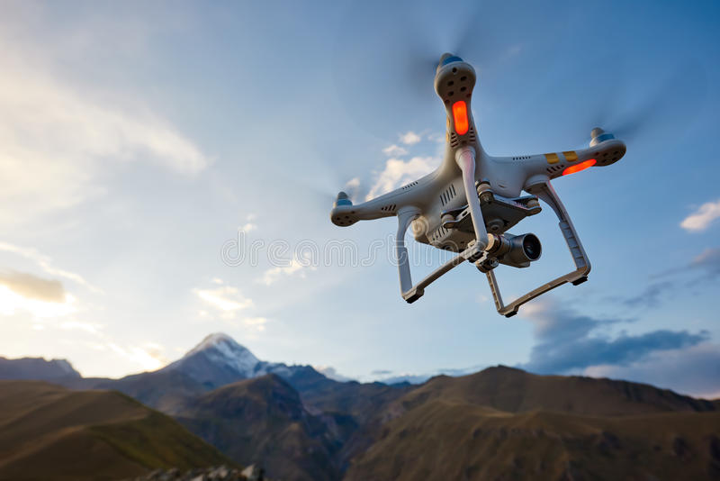 Uav drone copter flying with digital camera stock image