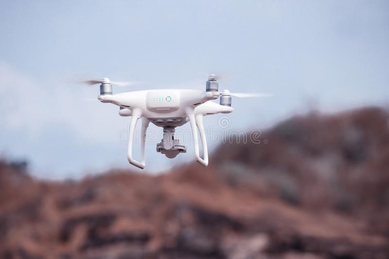 Uav drone copter flying with high resolution digital camera royalty free stock images