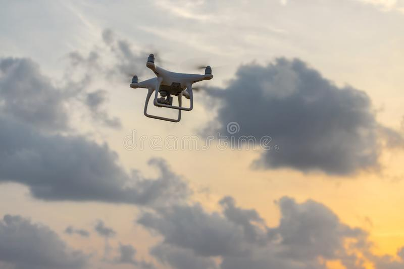 Uav drone copter flying with high resolution digital camera royalty free stock photo
