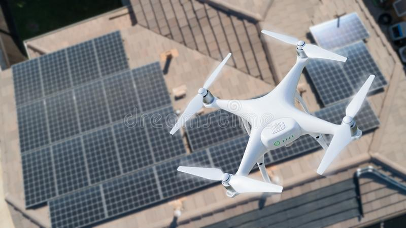 UAV Drone Inspecting Solar Panels On Large House. Roof Top stock photos