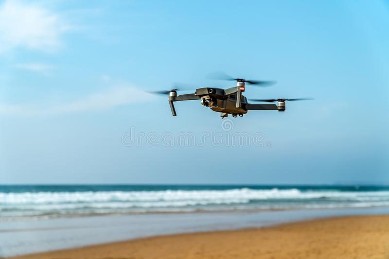 UAV Drone Quadcopter And Digital Camera Flying On Beach. UAV Drone Quadcopter And Digital Camera Flying At Beach stock photography