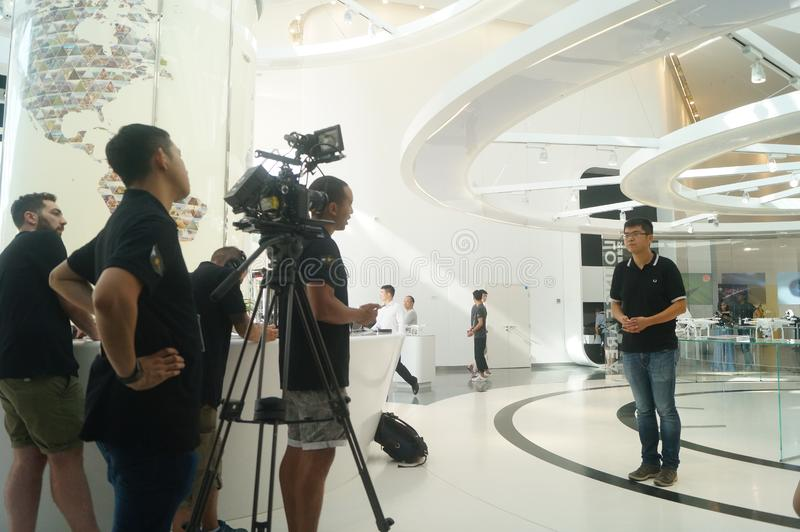 UAV exhibition hall. The unmanned air show hall shows many uavs. In Shenzhen, china. The media is doing a TV interview about unmanned aircraft royalty free stock image