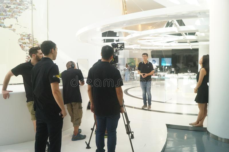 UAV exhibition hall. The unmanned air show hall shows many uavs. In Shenzhen, china. The media is doing a TV interview about unmanned aircraft royalty free stock photos