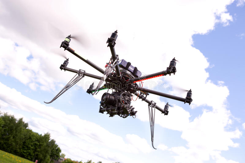 UAV Photography Helicopter. A photography multirotor helicopter with SLR camera attached stock image