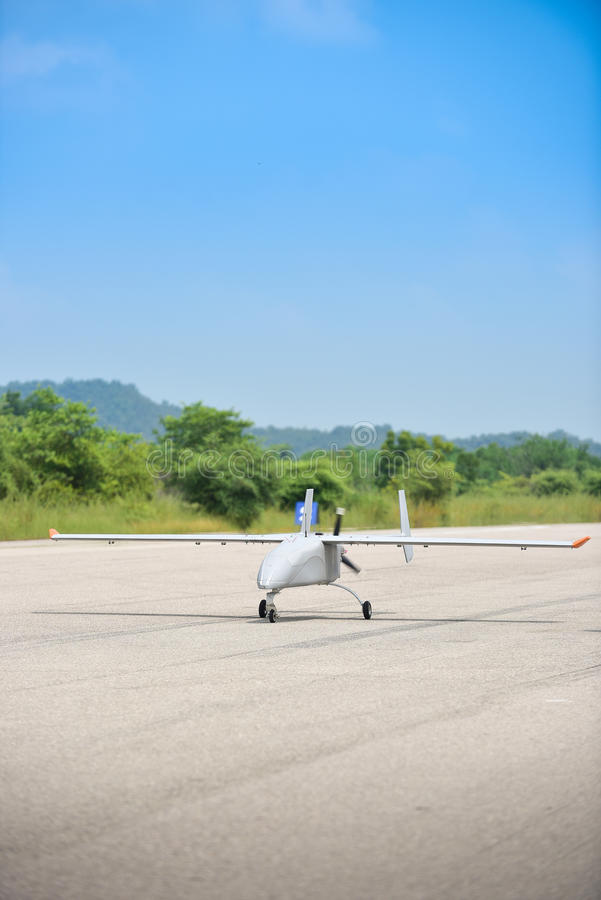 UAV static close up photo. Unmanned Aerial Vehicle, UAV. park in runway for take off. taxi way royalty free stock photography