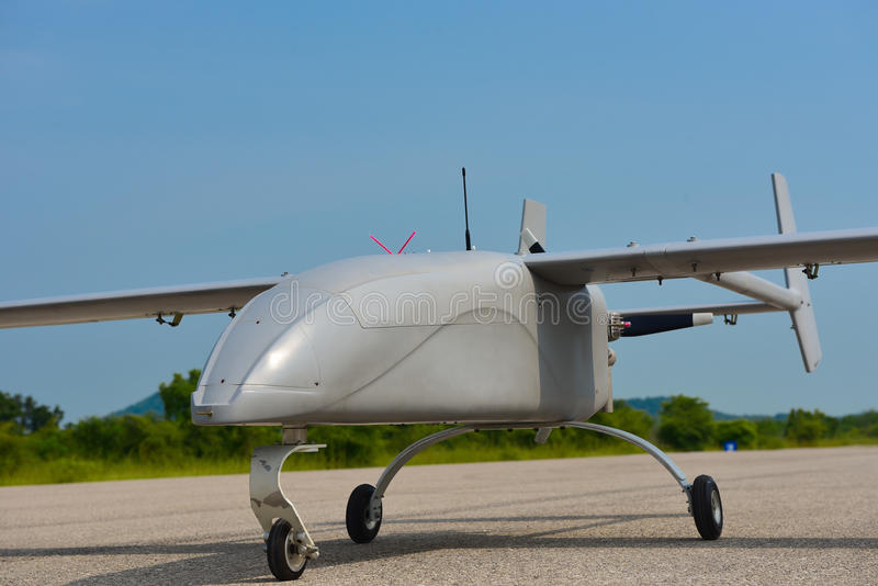 UAV static close up photo. Unmanned Aerial Vehicle, UAV. park in runway for take off. taxi way stock photography