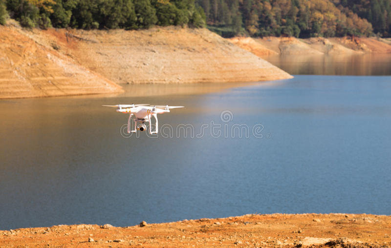 UAV Unmanned Drone Flight Flying Lake Shasta California. Blus skies over Lake Shasta and a UAV royalty free stock image