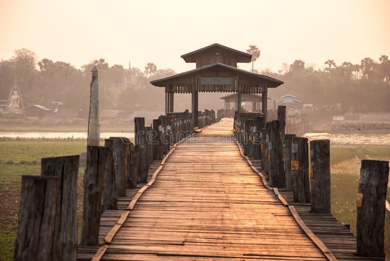 Ubein Bridge, Mandalay, Myanmar. Ubein Bridge at sunrise, Mandalay, Myanmar royalty free stock photo